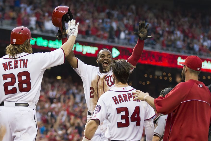 Washington Nationals Denard Span smiles as he crosses home plate after scoring the winning run on a throwing error by Arizona Diamondbacks third baseman Jordan Pacheco during the ninth inning of a baseball game on Thursday, Aug. 21, 2014, in Washington. The Nationals defeated the Diamondbacks. (AP Photo/Evan Vucci)
