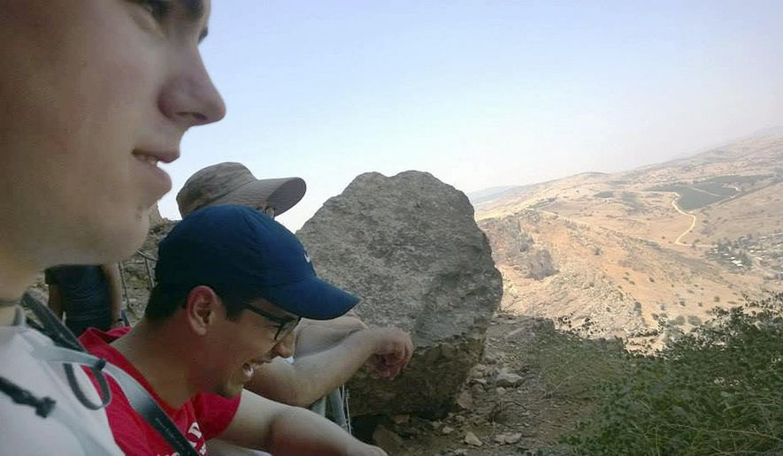 In this 2014 photo provided by Michigan State University, students in the school's Summer Study Abroad Program take a break while hiking in Israel. Some U.S. colleges have now pulled students from their overseas study programs in Israel as the Gaza war rages. Colleges site security as the top concern. (AP Photo/Michigan State University)
