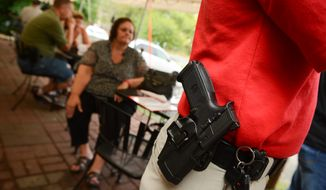 Patrons carry guns and eat dinner at The Cajun Experience during Second Amendment Wednesdays where patrons are allowed to open carry their guns, Leesburg, Va., Wednesday, August 20, 2014. (Andrew Harnik/The Washington Times)