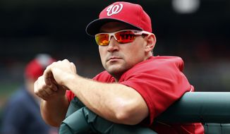 Washington Nationals left fielder Ryan Zimmerman rests in the dugout before a baseball game against the Philadelphia Phillies at Nationals Park Sunday, Aug. 3, 2014, in Washington. (AP Photo/Alex Brandon)
