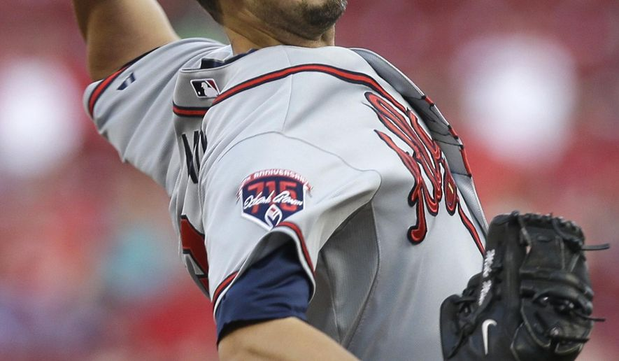 Atlanta Braves starting pitcher Mike Minor throws against the Cincinnati Reds in the first inning of a baseball game, Friday, Aug. 22, 2014, in Cincinnati. (AP Photo/Al Behrman)
