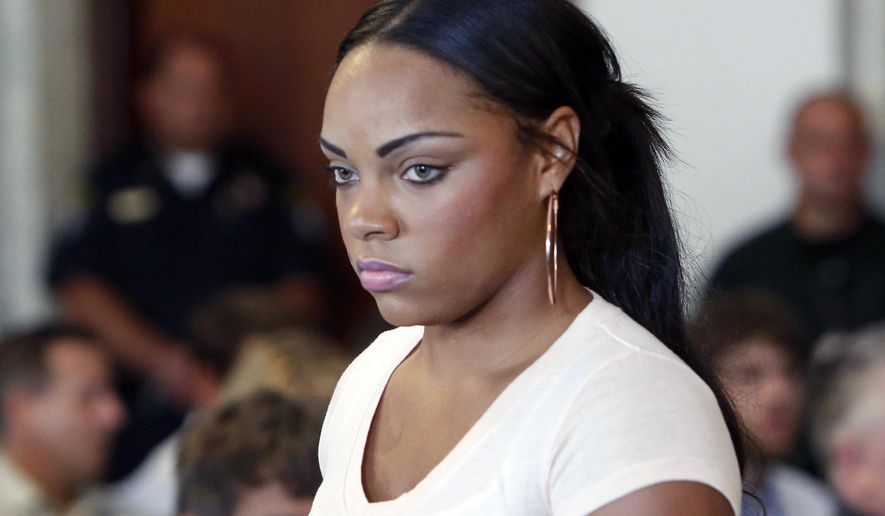 FILE - In this July 24, 2013, file photo, Shayanna Jenkins, fiancee of former New England Patriots NFL football player Aaron Hernandez, arrives at a hearing for Hernandez at Attleboro District Court in Attleboro, Mass. Her lawyers filed a motion Thursday, Aug. 14, 2014, in county court in Fall River, Mass., seeking to have perjury charges dismissed. She is charged with lying to a grand jury investigating the killing of Odin Lloyd, a semi-professional football player who was dating her' sister. Hernandez faces three murder charges, including in Lloyd's killing. (AP Photo/Bizuayehu Tesfaye, File)