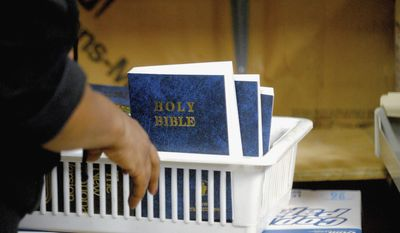 ** FILE ** In this July 28, 2014, photo, a bin with Bibles is seen at WXAN, a Christian radio station in Ava, Ill. (AP Photo/The Southern, Adam Testa)
