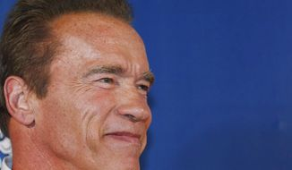 "Arnold Schwarzenegger smiles on the red carpet for the Macau premiere of his movie ""The Expendables 3"" in Macau, China, on Aug. 22, 2014. (Associated Press) **FILE**"