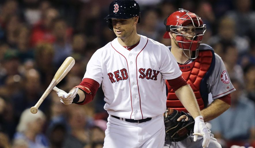 Boston Red Sox's Daniel Nava, left, flips his bat after striking out to end the seventh inning of a baseball game against the Los Angeles Angels in Boston, Thursday, Aug. 21, 2014. The Angels defeated the Red Sox 2-0. (AP Photo/Charles Krupa)