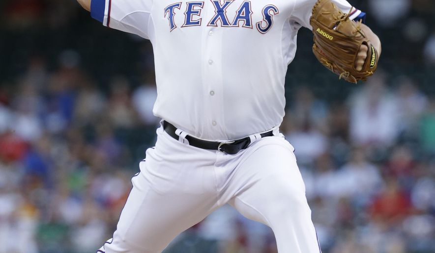 Texas Rangers starting pitcher Colby Lewis throws during the first inning of a baseball game against the Kansas City Royals, Friday, Aug. 22, 2014, in Arlington, Texas. (AP Photo/LM Otero)