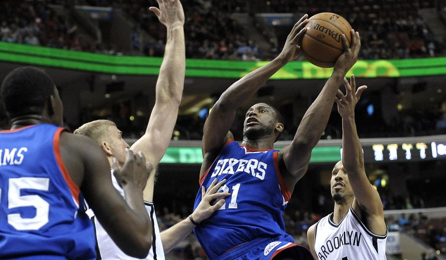 FILE - In this April 5, 2014, file photo, Philadelphia 76ers'  Thaddeus Young goes to the basket against the Brooklyn Nets during an NBA basketball game in Philadelphia. A person with knowledge of the situation told The Associated Press that the Minnesota Timberwolves will receive Thaddeus Young as part of the deal that will send Kevin Love to the Cleveland Cavaliers. The person requested anonymity because an official announcement has not been made. (AP Photo/Michael Perez, File)