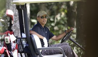 President Barack Obama sits in a golf cart while golfing at Farm Neck Golf Club, in Oak Bluffs, Mass., on the island of Martha's Vineyard, Thursday, Aug. 21, 2014. Obama is vacationing on the island. (AP Photo/Steven Senne)