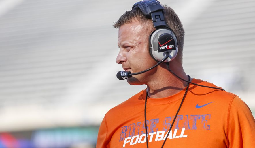 FILE - In this Aug. 15, 2014, file photo, Boise State head coach Bryan Harsin watches the action during the NCAA college football team's scrimmage in Boise, Idaho. Harsin is back at Boise State, after Chris Petersen left for Washington. His task now is to figure out how to keep the Broncos relevant on the national scene. (AP Photo/Otto Kitsinger, File)