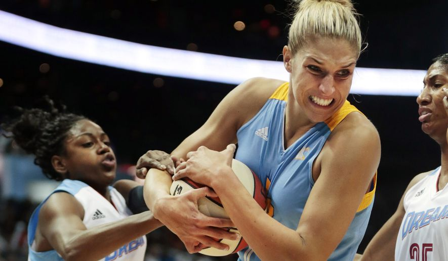 Chicago Sky's Elena Delle Donne, right, and Atlanta Dream's Tiffany Hayes, left, tussle for the ball during the first half of Game 1 of the WNBA basketball Eastern Conference semifinals, Friday, Aug. 22, 2014, in Atlanta. (AP Photo/John Bazemore)