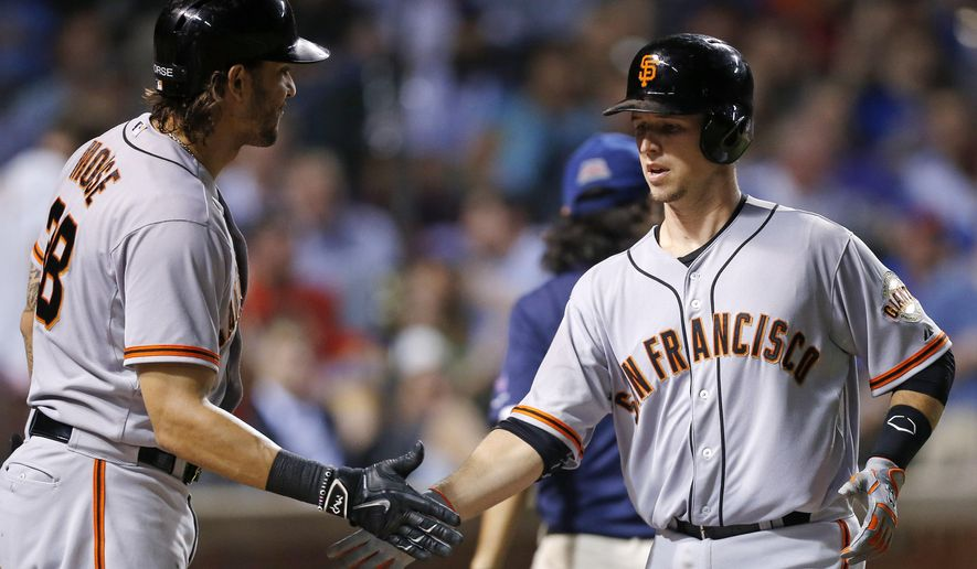 After hitting a solo home run, San Francisco Giants' Buster Posey, right, celebrates with teammate Michael Morse during the fifth inning of a baseball game against the Chicago Cubs, Thursday, Aug. 21, 2014, in Chicago. (AP Photo/Andrew A. Nelles)