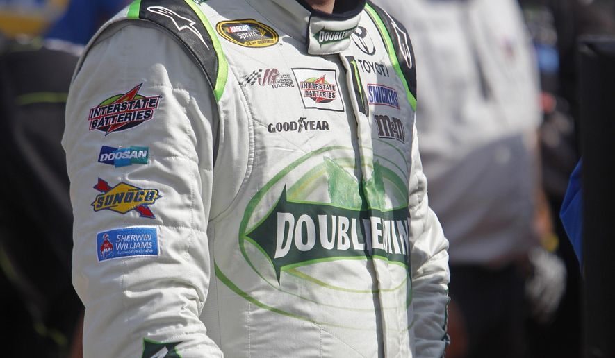 Driver Kyle Busch stands in the pit area after qualifying for the Food City 300 NASCAR Nationwide Series auto race at Bristol Motor Speedway on Friday, Aug. 22, 2014, in Bristol, Tenn. Busch will start on the pole. (AP Photo/Wade Payne)