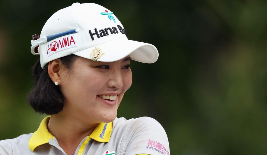 So Yeon Ryu, of South Korea, smiles during a delay in action on the third hole during second round play at the Canadian Pacific Women's Open golf tournament in London, Ontario, Friday, Aug. 22, 2014. (AP Photo/The Canadian Press, Dave Chidley)