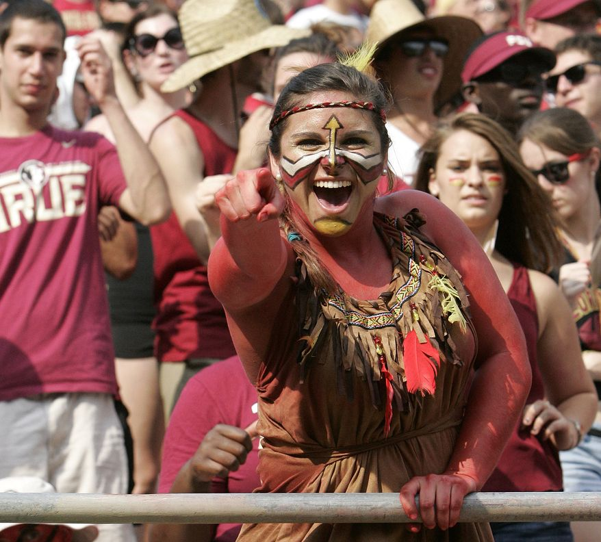 12. FLORIDA STATE UNIVERSITY, TALLAHASSEE FLORIDA. A Florida State fan shows her war paint against Nevada in an NCAA college football game on Saturday, Sept. 14, 2013, in Tallahassee, Fla. Florida State won the game 62-7. (AP Photo/Steve Cannon)