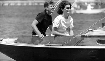 Sen. John F. Kennedy and Jacqueline Kennedy relax aboard the family yacht, Marlin, before sailing around Nantucket sound at Hyannis Port, Ma., on July 19, 1960.  (AP Photo)
