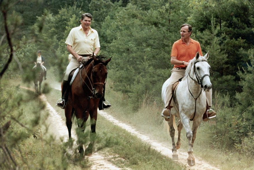 In this photo released by the White House, U.S. President Ronald Reagan, left, and Vice President George Bush go horseback riding at Camp David, Md., July 1981.  (AP Photo/White House, Michael Evans)