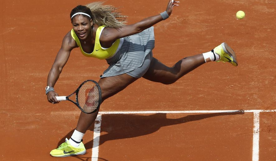 FILE - In this May 25, 2014, file photo, Serena Williams returns the ball during a first round match of the French Open tennis tournament against France's Alize Lim at the Roland Garros stadium, in Paris, France. Serena Williams could become the first woman in nearly 40 years to win three consecutive U.S. Opens, but she has not been past the fourth round at a major in 2014.(AP Photo/Darko Vojinovic, File)