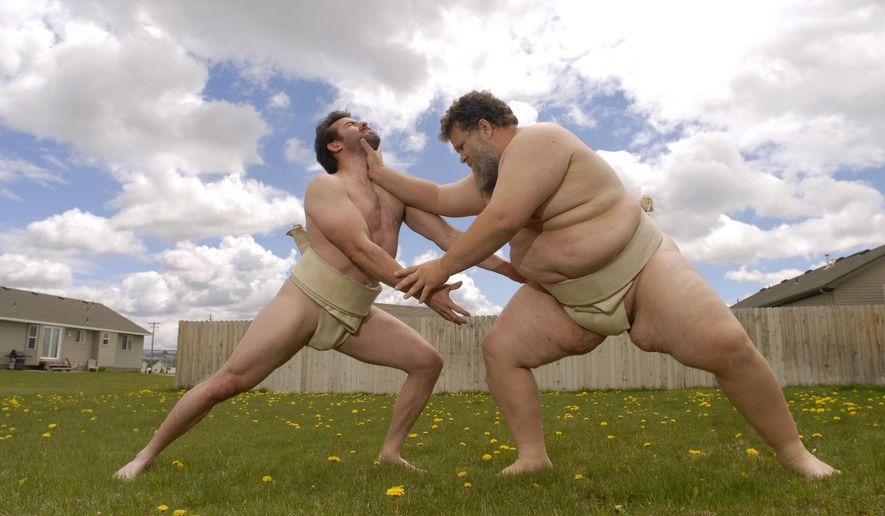 ADVANCE FOR WEEKEND AUG. 23-24  FILE - This May 19, 2010 picture shows Kelly Gneiting, right, a 420-pound sumo wrestler, who's been ranked among the top in the world, wrestling with Trent Sabo, a ranked sumo wrestler in the lightweight category in Idaho Falls, Idaho. Gneiting has competed in the World Sumo Championships 10 times, is a five-time U.S. sumo champion, and also holds the world record for being the heaviest man to complete a marathon, It was about two years ago when a friend set him off on his latest athletic passion, swimming, and Gneiting eventually plans to swim the English Channel.(AP Photo/The Idaho State Journal, Doug Lindley)