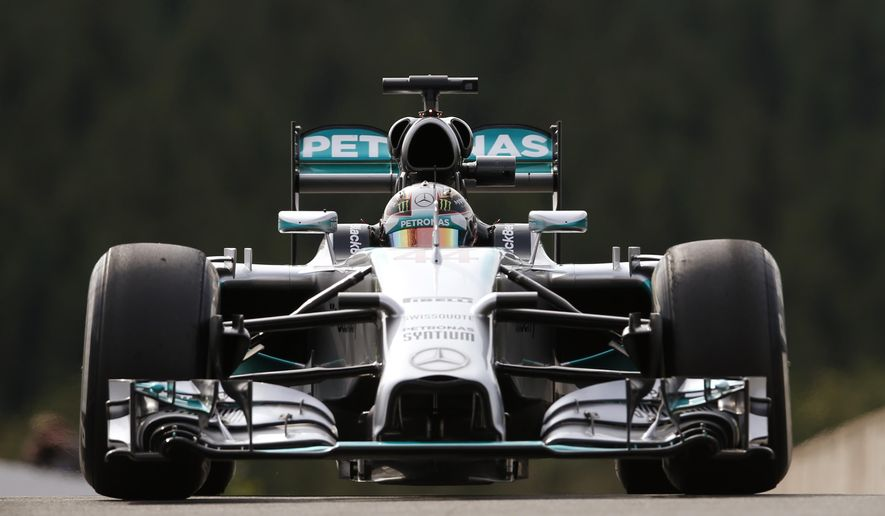 Mercedes driver Lewis Hamilton of Britain steers his car during the first free practice at the Spa-Francorchamps circuit, Belgium, Friday, Aug. 22, 2014. The Belgium Formula One Grand Prix will be held on Sunday. (AP Photo/Luca Bruno)