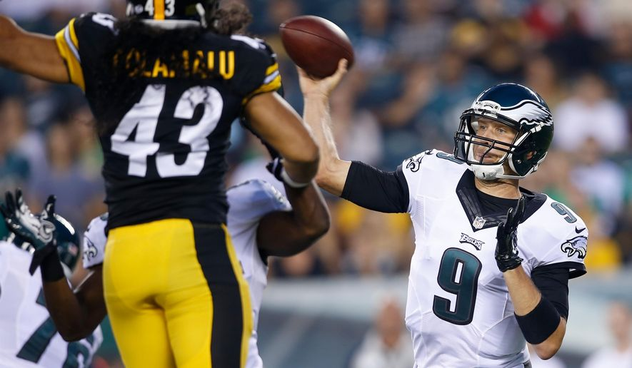 Philadelphia Eagles quarterback Nick Foles, right, passes during the first half of an NFL preseason football game against the Pittsburgh Steelers, Thursday, Aug. 21, 2014, in Philadelphia. (AP Photo/Michael Perez)