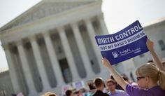 This June 30, 2014, file photo shows a demonstrator holding up a sign outside the Supreme Court in Washington. Seeking to quell a politically charged controversy, the Obama administration announced new measures Friday to allow religious nonprofits and some companies to opt out of paying for birth control for female employees while still ensuring those employees have access to contraception.  (AP Photo/Pablo Martinez Monsivais, File)