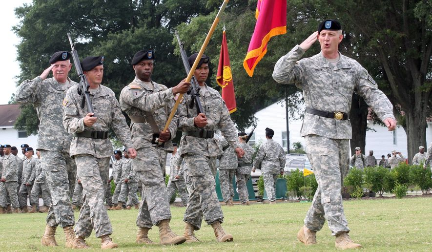 Troops march and salute Maj. Gen. Stephen R. Lyons, the new commanding officer, during a change of command ceremony Friday, Aug. 22, 2014, at Fort Lee, Va. Lyons arrived from  Fort Shafter, Hawaii. (AP Photo/The Progress-Index, Patrick Kane)