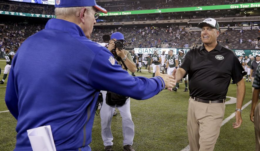 New York Jets head coach Rex Ryan, right, greets New York Giants head coach Tom Coughlin after a preseason NFL football game, Friday, Aug. 22, 2014, in East Rutherford, N.J.  The Giants won 35-24. (AP Photo/Julio Cortez)