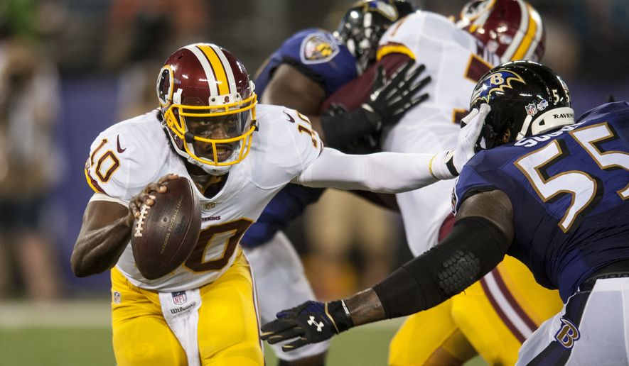 Washington Redskins' quarterback Robert Griffin III scrambles during second quarter action against the Baltimore Ravens during the first quarter of their pre-season game at M&T Bank Stadium on August 23, 2014 in Baltimore, Maryland. (Pete Marovich Special to The Washington Times)