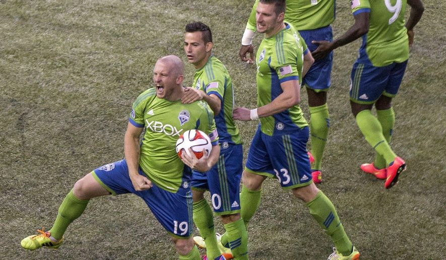 Seattle Sounders' Chad Barrett celebrates his goal against the San Jose Earthquakes during the second half of an MLS soccer game Wednesday, Aug. 20, 2014, in Seattle. (AP Photo/The Seattle Times, Dean Rutz)