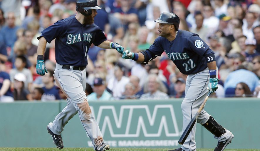 Seattle Mariners' Dustin Ackley, left, celebrates his three-run home run with Robinson Cano during the fourth inning of a baseball game against the Boston Red Sox in Boston, Saturday, Aug. 23, 2014. (AP Photo/Michael Dwyer)