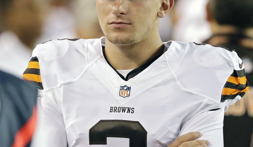 Cleveland Browns quarterback Johnny Manziel watches from the bench in the first quarter of a preseason NFL football game against the St. Louis Rams Saturday, Aug. 23, 2014, in Cleveland. (AP Photo/Tony Dejak)