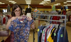 Melissa Torres, of Horicon, Wis., hangs and prices clothing items during her shift at the Bethesda Thrift Shop, in Horicon. Torres is one of 20 people with intellectual and developmental disabilities employed through a Bethesda Lutheran Communities program, its Ability Hire Initiative, that provides supported, integrated employment opportunitites at the organization's thrift shops located in Wisconsin and across the Midwest. (AP Phoyo/Bethesda Lutheran Communities)