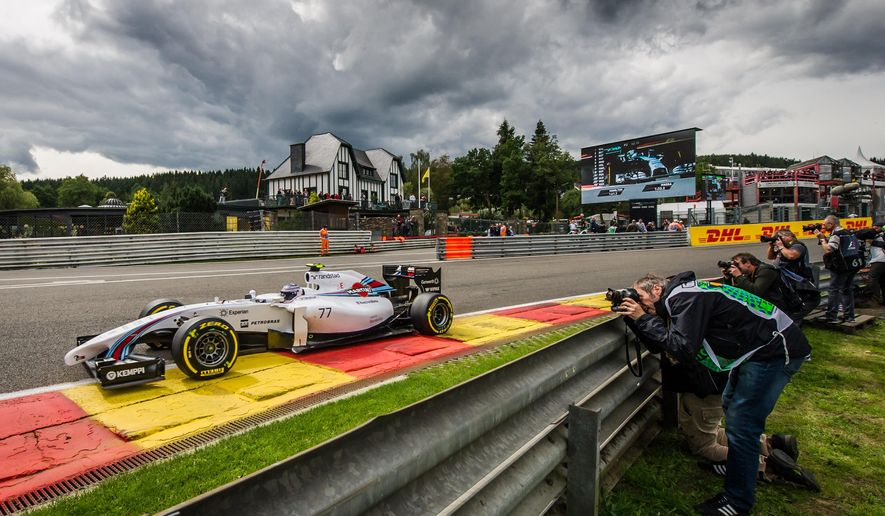 Williams driver Valtteri Bottas of Finland steers his car during the second practice session ahead of Sunday's Belgian Formula One Grand Prix in Spa-Francorchamps, Belgium, Friday, Aug. 22, 2014. (AP Photo/Geert Vanden Wijngaert)