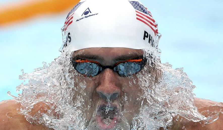 Michael Phelps of the U.S.  swims breaststroke during his men's 200m individual medley at the Pan Pacific swimming championships in Gold Coast, Australia, Sunday, Aug. 24, 2014. (AP Photo/Rick Rycroft)
