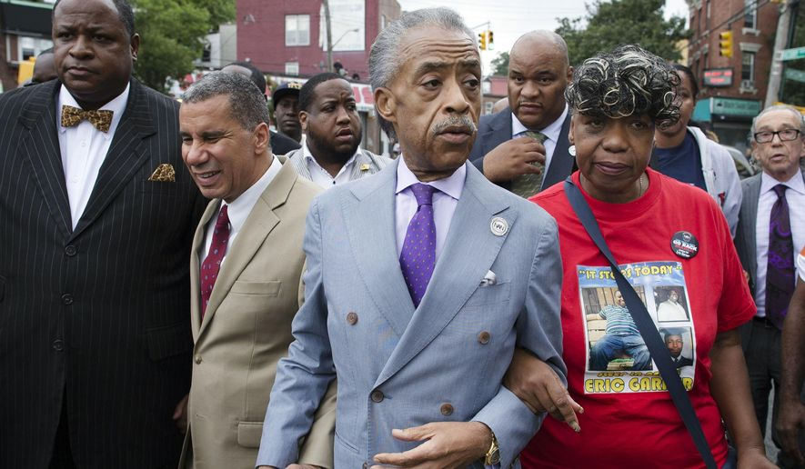The Rev. Al Sharpton, second from right, walks with former New York Gov. David Paterson, second from left, and Gwen Carr, right, mother of Eric Garner, as they arrive before a march to protest the death of Eric Garner, Saturday, Aug. 23, 2014, in the Staten Island borough of New York. The afternoon rally and march was led by Sharpton and relatives of Garner, who died July 17 after a New York Police Department officer took him to the ground with a banned tactic in a confrontation captured on video. (AP Photo/John Minchillo) **FILE**