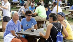 Crowds begin to gather at the Connecticut open tennis tournament in New Haven, Conn., on Saturday, Aug. 23, 2014. Attendance was up at the tournament for the first time since 2005.  (AP Photo/Fred Beckham)