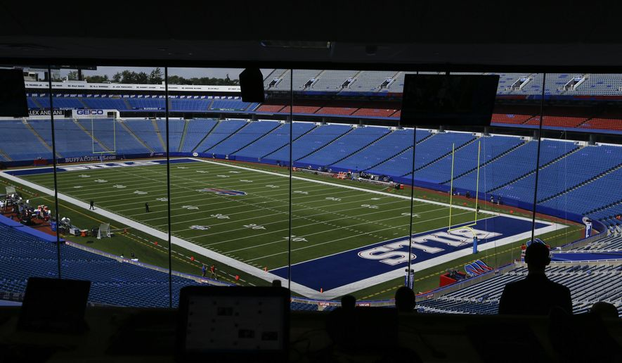People observe the field at Ralph Wilson Stadium before a preseason NFL football game between the Buffalo Bills and the Tampa Bay Buccaneers Saturday, Aug. 23, 2014, in Orchard Park, N.Y. (AP Photo/Frank Franklin II)