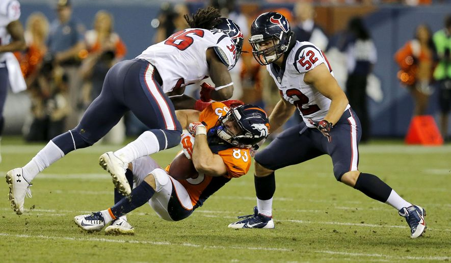 Denver Broncos wide receiver Wes Welker (83) is hit by Houston Texans strong safety D.J. Swearinger (36) and Jeff Tarpinian (52) during the first half of an NFL preseason football game, Saturday, Aug. 23, 2014, in Denver. (AP Photo/Jack Dempsey)