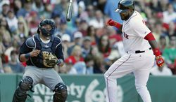 Boston Red Sox's David Ortiz, right, twists and releases his bat beside Seattle Mariners' Jesus Sucre after being hit by a pitch during the sixth inning of a baseball game in Boston, Saturday, Aug. 23, 2014. (AP Photo/Michael Dwyer)