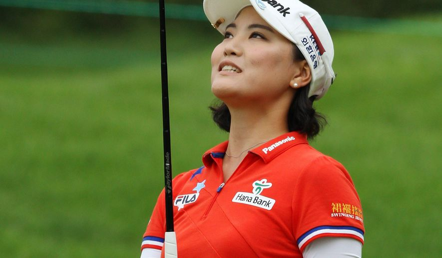 So Yeon Ryu of South Korea reacts to her putt on the second hole during the third round of the Canadian Women's Open golf tournament in London, Ontario, on Saturday, Aug. 23, 2014. (AP Photo/The Canadian Press, Dave Chidley)