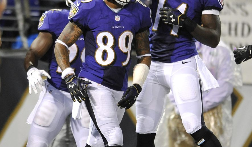 Baltimore Ravens wide receiver Steve Smith, center, celebrates his touchdown with teammates Marlon Brown, right, and Justin Forsett in the first half of an NFL preseason football game against the Washington Redskins, Saturday, Aug. 23, 2014, in Baltimore. (AP Photo/Gail Burton)