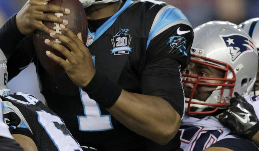 New England Patriots defensive end Rob Ninkovich, right, sacks Carolina Panthers quarterback Cam Newton (1) in the first half of an NFL preseason football game Friday, Aug. 22, 2014, in Foxborough, Mass. (AP Photo/Charles Krupa)