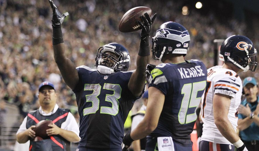Seattle Seahawks' Christine Michael (33) celebrates his touchdown reception as Jermaine Kearse (15) watches, against the Chicago Bears in the first half of a preseason NFL football game, Friday, Aug. 22, 2014, in Seattle. (AP Photo/John Froschauer)