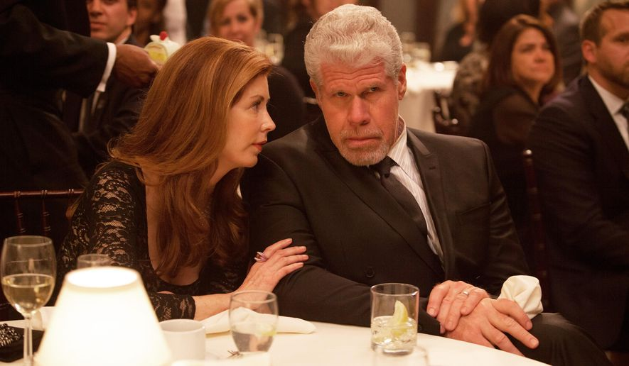 """This image provided by Amazon Studios shows Dana Delany, left, and Ron Perlman in a sceen from """"Hand of God."""" The gutsy drama, which centers on """"Sons of Anarchy"""" and """"Hellboy"""" star Ron Perlman as a judge who believes God is guiding him after his family is attacked, is among the latest batch of potential series that'll be streamed online beginning Aug. 28 by Amazon. (AP Photo/Amazon Studios, Karen Ballard)"""
