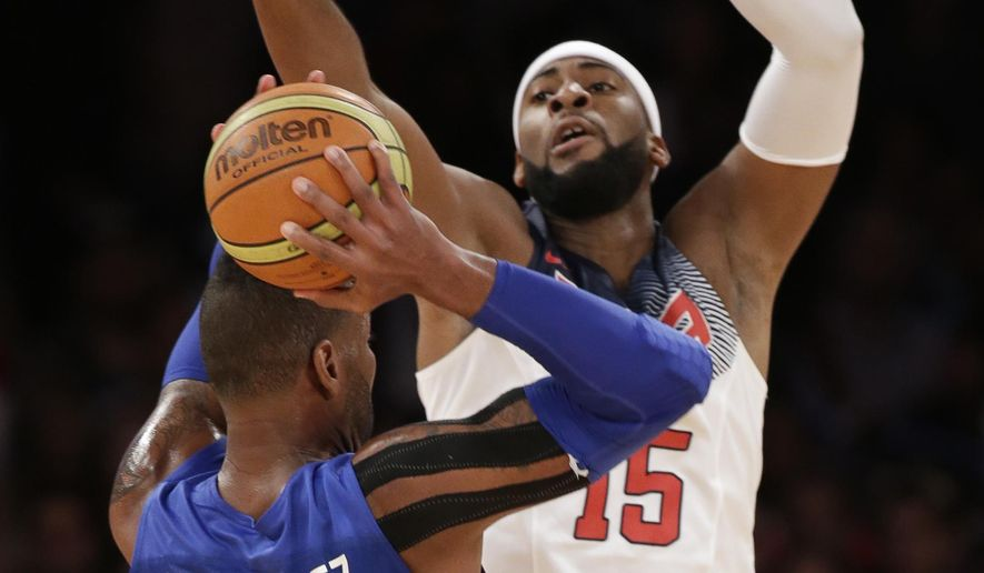U.S. center Andre Drummond, rear, defends Dominican Republic center Jack Michael Martinez during the first half of an exhibition basketball game at Madison Square Garden in New York, Wednesday, Aug. 20, 2014. The United States won 105-62. (AP Photo/Kathy Willens)