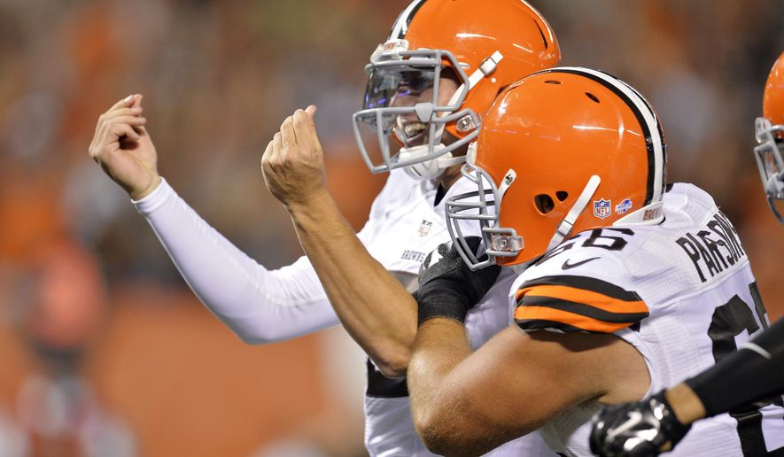 Cleveland Browns quarterback Johnny Manziel celebrates after a 7-yard touchdown run against the St. Louis Rams in the third quarter of a preseason NFL football game Saturday, Aug. 23, 2014, in Cleveland. (AP Photo/David Richard)