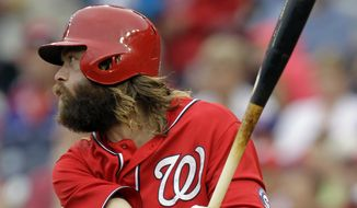 Washington Nationals' Jayson Werth follows through on an RBI-single during the second inning of a baseball game against the San Francisco Giants, Saturday, Aug. 23, 2014, in Washington. (AP Photo/Luis M. Alvarez)