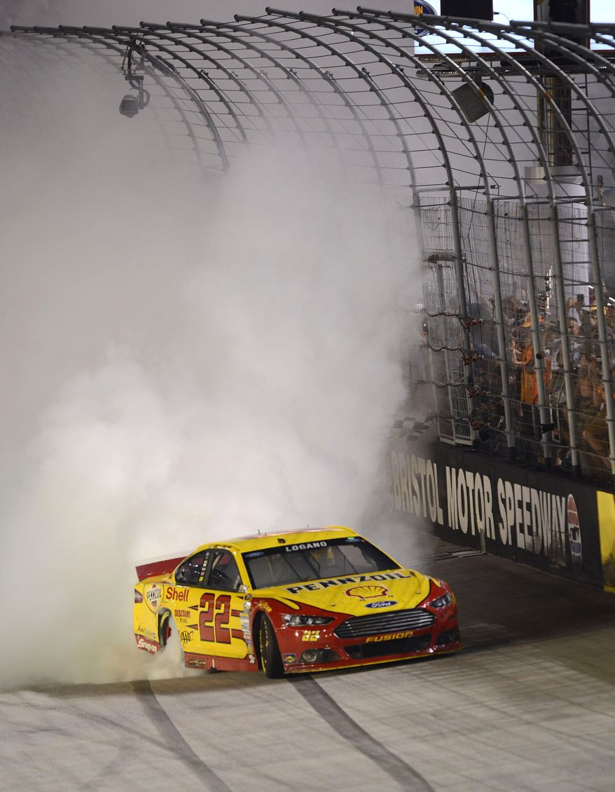 Joey Logano celebrates his win in a NASCAR Sprint Cup Series auto race at Bristol Motor Speedway on Saturday, Aug. 23, 2014, in Bristol, Tenn. (AP Photo/The Bristol Herald-Courier, Andre Teague)