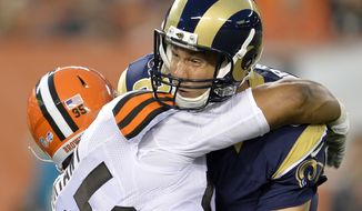 St. Louis Rams quarterback Sam Bradford is hit by Cleveland Browns defensive end Armonty Bryant (95) in the first quarter of a preseason NFL football game Saturday, Aug. 23, 2014, in Cleveland. Bradford left the game and was taken to the locker room after the play. (AP Photo/David Richard)
