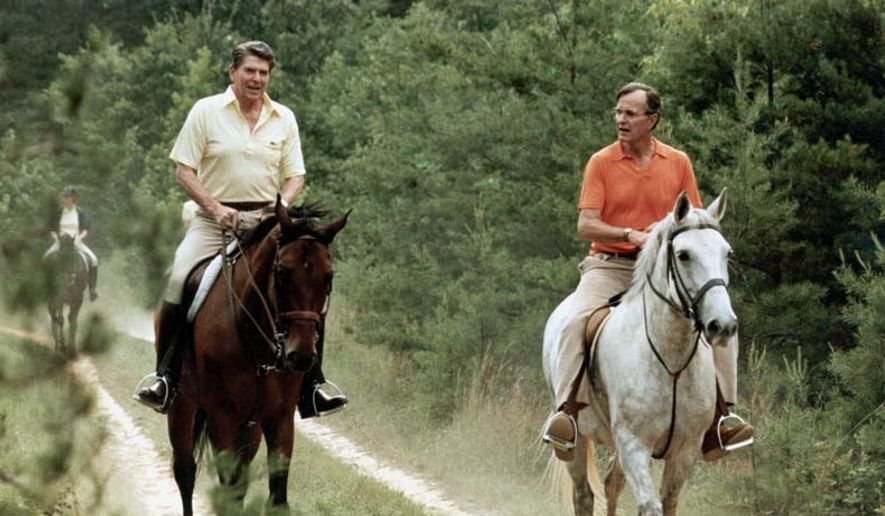 ** FILE ** U.S. President Ronald Reagan, left, and Vice President George Bush go horseback riding at Camp David, Md., July 1981. (Associated Press)